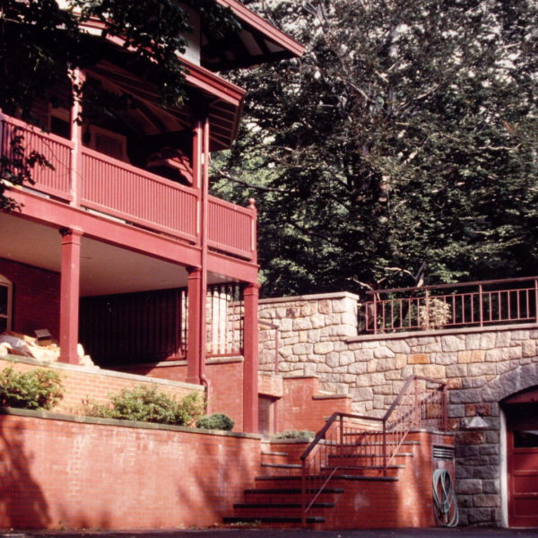 View of rear entry steps and garage
