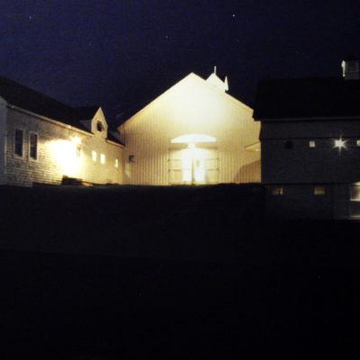 View looking at the entry façade at night